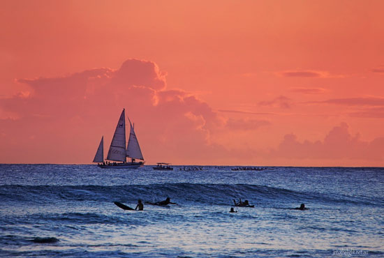 Hawaii sunset surf and sail